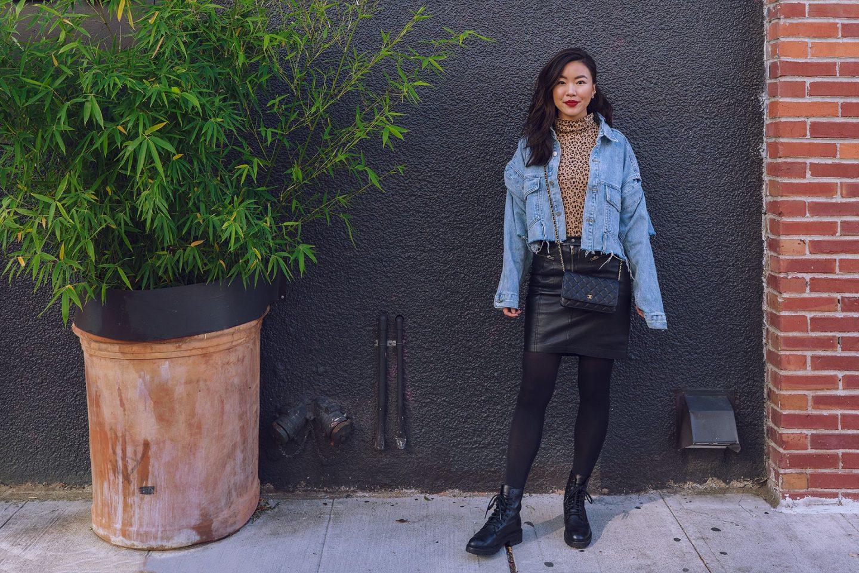 leopard turtleneck leather skirt combat boots denim jacket